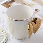 Cheap white pearl glazed ceramic mugs with wing shaped handle china manufacturers